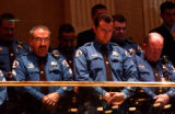 (DENVER, Colo., May 2, 2005) Arapahoe County Sheriff's deputies, bow their heads during prayer as...