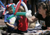 Debbie Friedly (cq), right, of Brighton, Colo., adjusts a balloon hat for her 5-year-old foster...