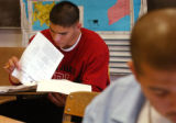 (far Lt.) Denver North High School senior Matt Santovena (cq), works on his Introduction to Law...