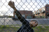 DeShawn Joyce (cq), 9, hangs on a fence after playing at the park while near Samaritan House...