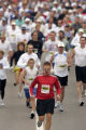 Ty Godwin, 42, of Centennial, Colo., is trailed by some of the nearly 10,000 participants who took...
