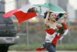 Jessica Valles, 14, runs at the corner of Federal and 5th avenue as she gets atention from...