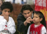 Durwin Sauer (cq), center, points out the route to his son Chance Sauer (cq), 9, right, while...