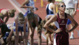 Alamosa's Laura Knapp, right, seems unfazed by her 2:16.63 4A Girls 800 meter run during the...