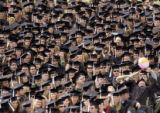 The traditional beach ball is tossed amongst a crowd of University of Colorado graduates during...