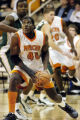 (Photo by Woody Marshall) 020104 Mercer University's #40 Wesley Duke drives  to the basket agianst...