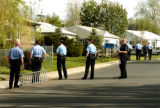 Police officers search the neighborhood around the Salon Ocampo located at 1733 W. Mississippi...