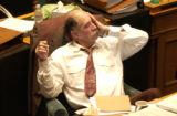 Rep. Wes McKinley sits through the  waning moments in the Colorado House of Representatives in the...