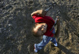 Warren Two Crow Jr. (cq), 8, plays on the swings at Crofton Elementary in Denver, Colo., on...