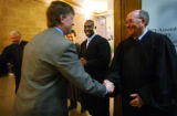 (Lt. to Rt.) Denver Mayor John Hickenlooper chats with Judge's Robert Crew (cq), Johnny Barajas...