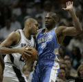 Denver Nuggets Nene, right, blocks the progress of  San Antonio Spurs Tim Duncan in the second...