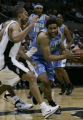 Denver Nuggets Andre Miller drives to the basket against the San Antonio Spurs Tony Parker in the...