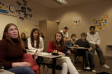 (CENTENNIAL, Colo., January 5, 2005) Megan Vulasovich, left in brown sweater, makes point about...