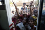 (1/18/05, Singarathoppu , India)   Children say good-bye to the crew as they leave the camp for...