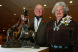 G. Marvin Beeman and his wife, Eunice, behind a bronze sculpture of George's father, George...