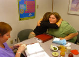 (DENVER, CO., MAY 24, 2004)  Dayla Weskamp, 18, right, gets a hug from Teresa McCann, Registered...