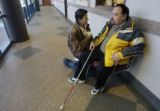 Centennial,  Colorado-Jan. 7 2005.   Peter Spitz waits for transportation with his friend Jacque...