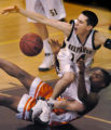 (LITTLETON, CO., JANUARY 20, 2005)   Arapahoe's #14, Mike Annese, top, (white jersey) and...