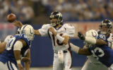 (INDIANANPOLIS., JANUARY 09, 2005)  Denver Broncos' quarterback, #16, Jake Plummer, center,  gets...