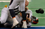 (INDIANANPOLIS., JANUARY 09, 2005)  CAPTION CORRECTION Denver Broncos' #56, Al Wilson is held down...