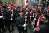 9/11 story.   New York on Sept 10, 2006.   Members of the NYFD stand outside St. Patrick's...
