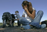 Summer Lawless, CQ, right, and her two boys Bradley, 4, left, and Easton, 2, center play at the...