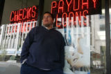 Matthew Smith, cq, Denver, waits for a friend outside Cash Payday Express on Stout Street in...