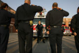 DLM02126   Engineer Jeff Hood checks the firefighters' formation as they prepare for a memorial...