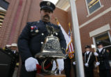 DLM02299   Engineer Christopher McCarthy rings the bell in the last alarm signal, four series of...