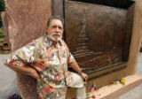 "DLM02795   Sculptor Reynaldo ""Sonny"" Rivera stands in front of one of the bronze reliefs..."