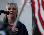 Linda Olson(cq) sings the U.S. national anthem in observance of the five-year anniversary of the...