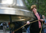 9/11 story.   New York on Sept 11, 2006.  Jo Ann Meehan (cq), of Cateret, New Jersey, rings a bell...