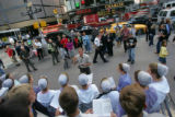 9/11 story.   New York on Sept 11, 2006.   Menonnites from North Carolina and Massachusetts sings...