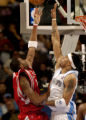 (Denver, CO., January 9, 2004) Kenyon Martin tries to block a shot by Tracy McGrady in the second...
