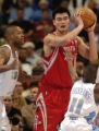 (Denver, CO., January 9, 2004) Marcus Camby and Earl Boykins defend against Yao Ming in the second...