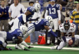 (INDIANAPOLIS, Ind. - Shot 1/9/2005) The Denver Broncos' Chris Young (#32, S) scoops up a fumbled...