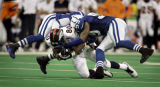 (INDIANAPOLIS, Ind. - Shot 1/9/2005) The Denver Broncos' Rod Smith (#80, WR) is tackled by the...