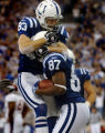 (INDIANANPOLIS., JANUARY 09, 2005)  Indianapolis Colts' #87, Reggie Wayne, right, is mobbed by...