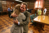 MJM031  Cole Finegan, the mayor's acting chief of staff and the city attorney, gets a hug from...