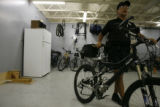 DLM03720   Police officer Ed Valerio, 62, walks his bicycle out of the garage for his last patrol...