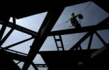 DLM03980   Jaret Heffernan, 25, of Denver walks across a steel girder while welding roof panels...