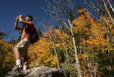 MJM724  Matt Kepnes (cq), 25, photographs the changing color of the aspen trees at Rocky Mountain...