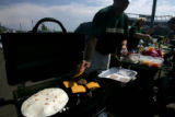 Spotlight food Cover story on tailgating at college football games. Tim O'Hara get his burgers...