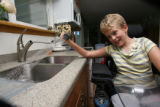 Going, Going, Soaked!!! Julia, 10, takes careful aim at everything and the kitchen sink in the...