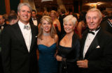 The Children's Hospital Gala 2006 co-chairmen Scott and Virginia Reiman, left, are joined by...