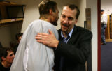 Steve Konowalchuk(cq) gets a hug from Kurt Sauer(cq) in the practice locker-room following a press...