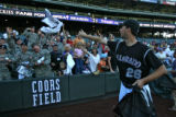 Rockies pitcher Jeff Francis throws gifts to the fans after the game Thursday afternoon September...