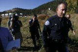 DLM00552   Park County Sheriff Fred Wegener makes his way to a 4:00 p.m. press conference where he...