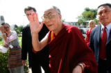 Flanked by security, the Dalai Lama walks into the Newman Center on the DU campus for Peace Jam...