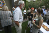 Bill Hanna, left with gray hair and glasses, was a host and here talks with England students,...